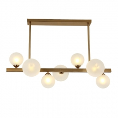 Mid Century Modern 7 Light Aged Brass Bubble Beam Island Linear Chandelier with Opaline Glass Globes